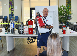 Fire Marshal Steve Paine Displays Fire Extinguisher