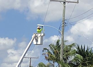 FPL worker installs new LED light fixture