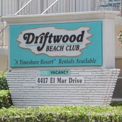 Blue Driftwood Beach Club Sign